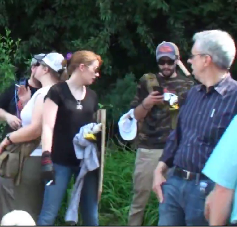 "David Aaron Mitchell (right, wearing an ""Exodus Americanus"" t-shirt), Jennifer Mitchell (left, wearing a black t-shirt) at the ""Unite the Right"" rally, Charlottesville, 2017."